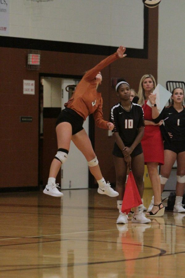Macy Pregner 19 serves the ball.