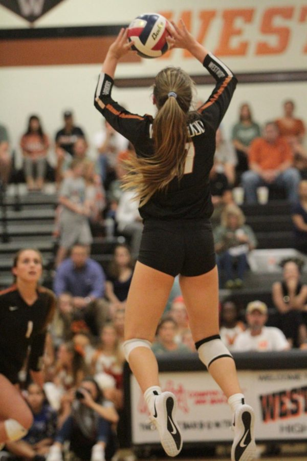 Kenzie Beckham 21 hits the ball to the opposing side in attempt to score a point.