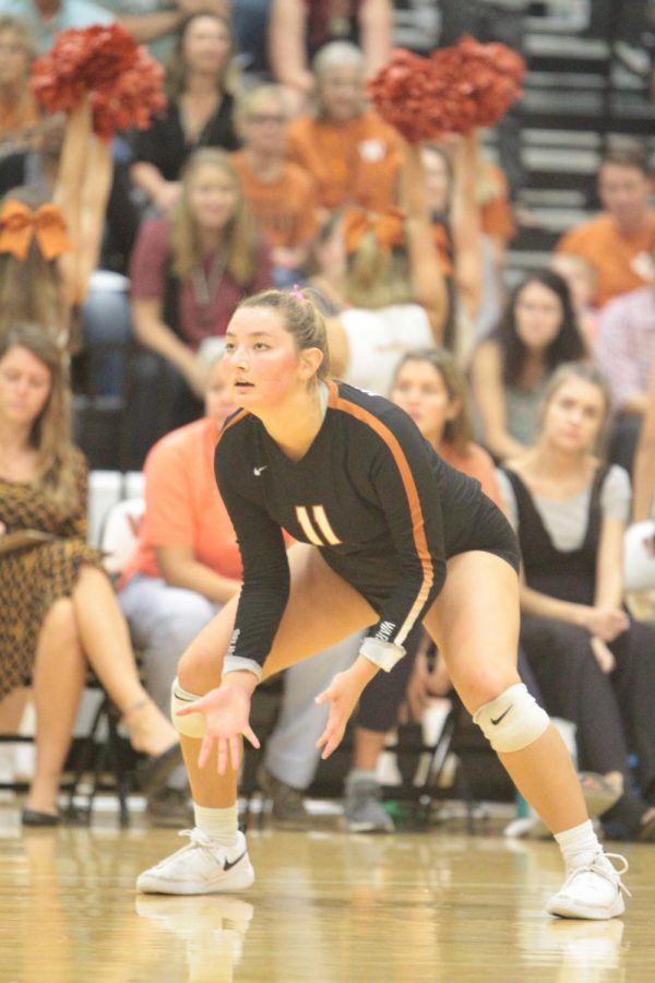 Abi Rucker 20 watches the ball and prepares to make a play.