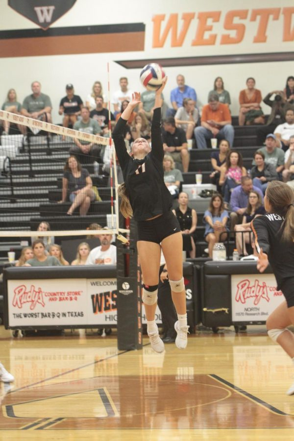 Kenzie Beckham 21 sets the ball for teammate Abby Gregorczyk 21.