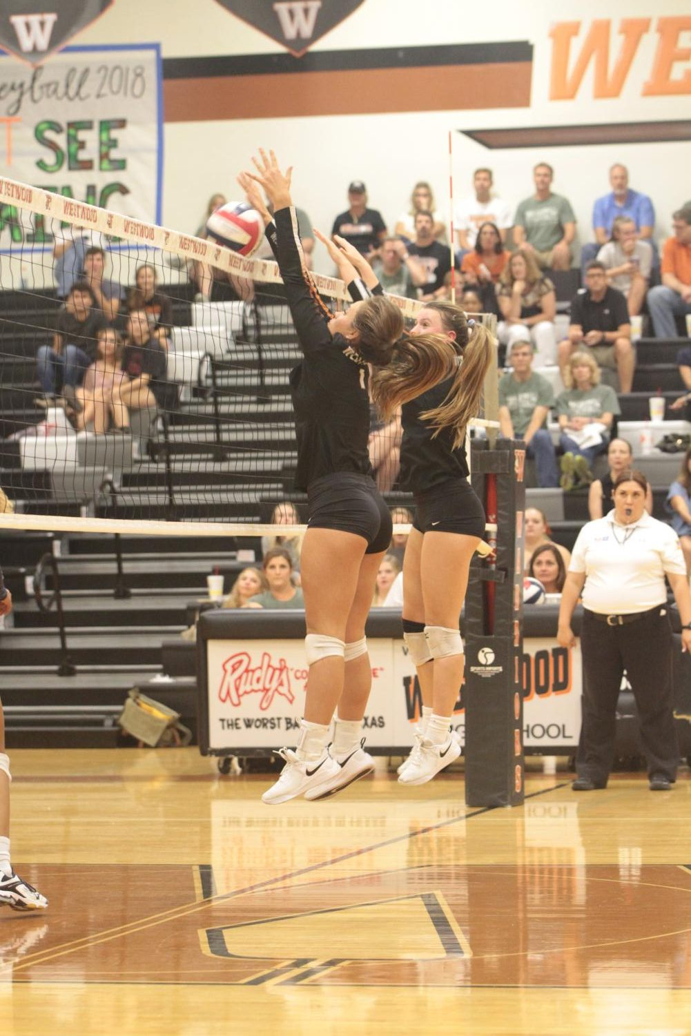 Abby+Gregorczyk+%2721+and+Kenzie+Beckham+%2721+jump+up+to+block+the+ball+from+entering+their+half+of+the+court.