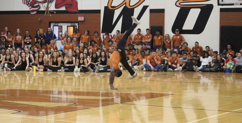 Eric+Hawkins+%2719+cartwheels+across+the+gym.