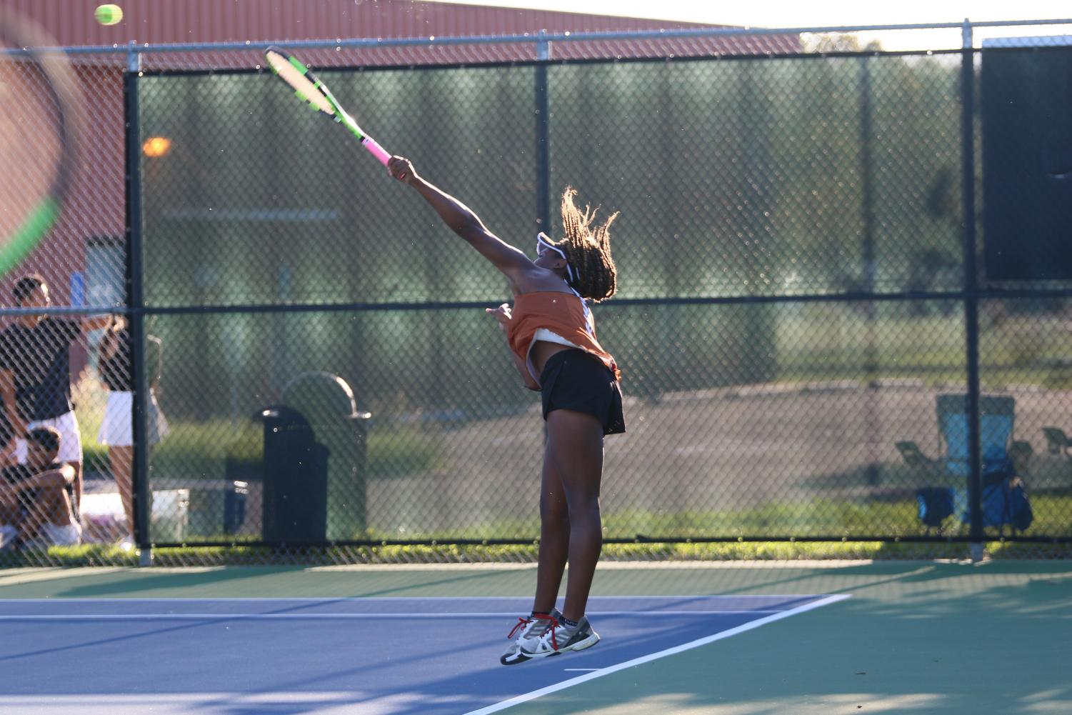 Kiana+Graham+%2720+jumps+as+she+serves+to+her+opponent.
