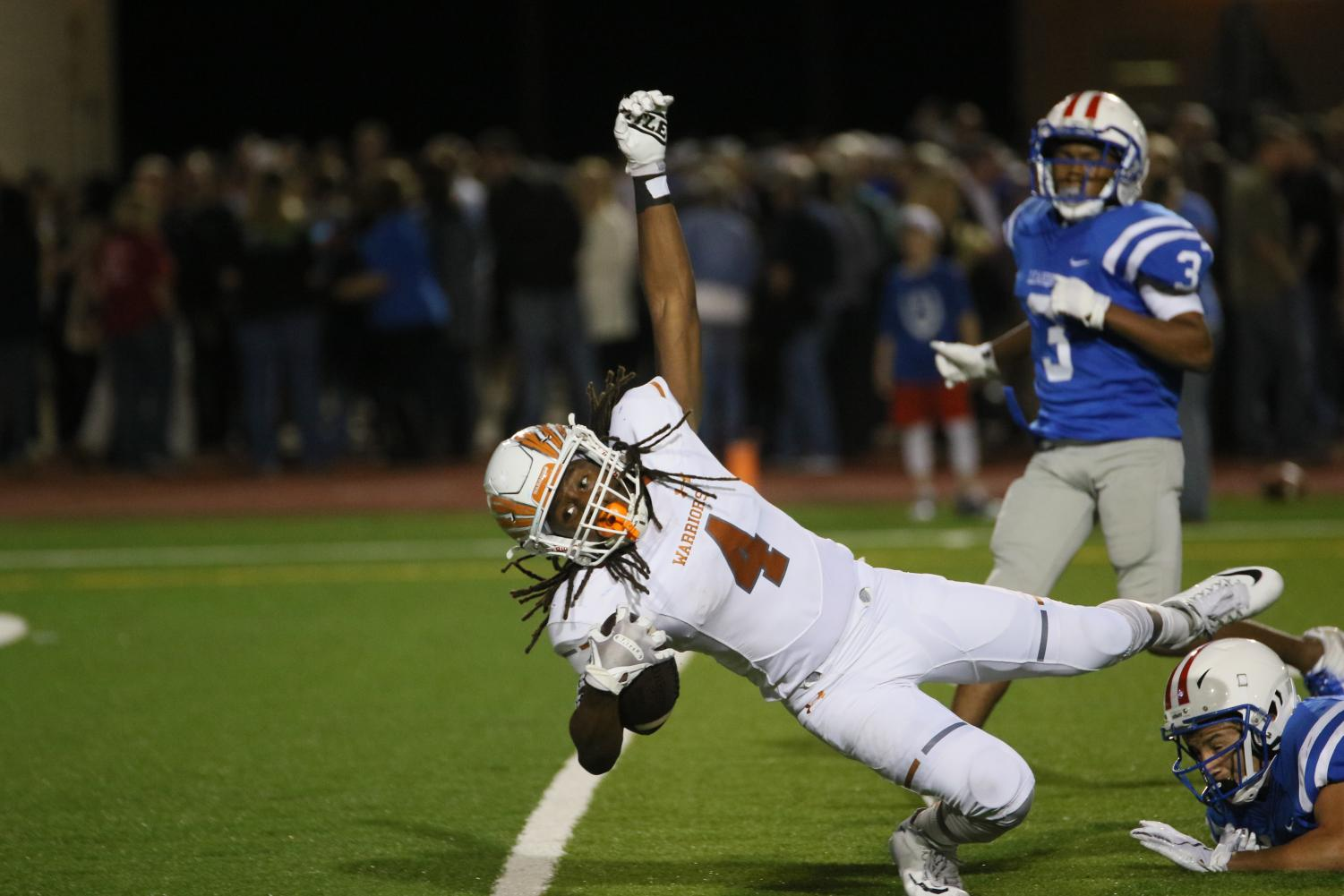 Clinging onto the ball, Nate Anderson '21 reaches for the end zone.
