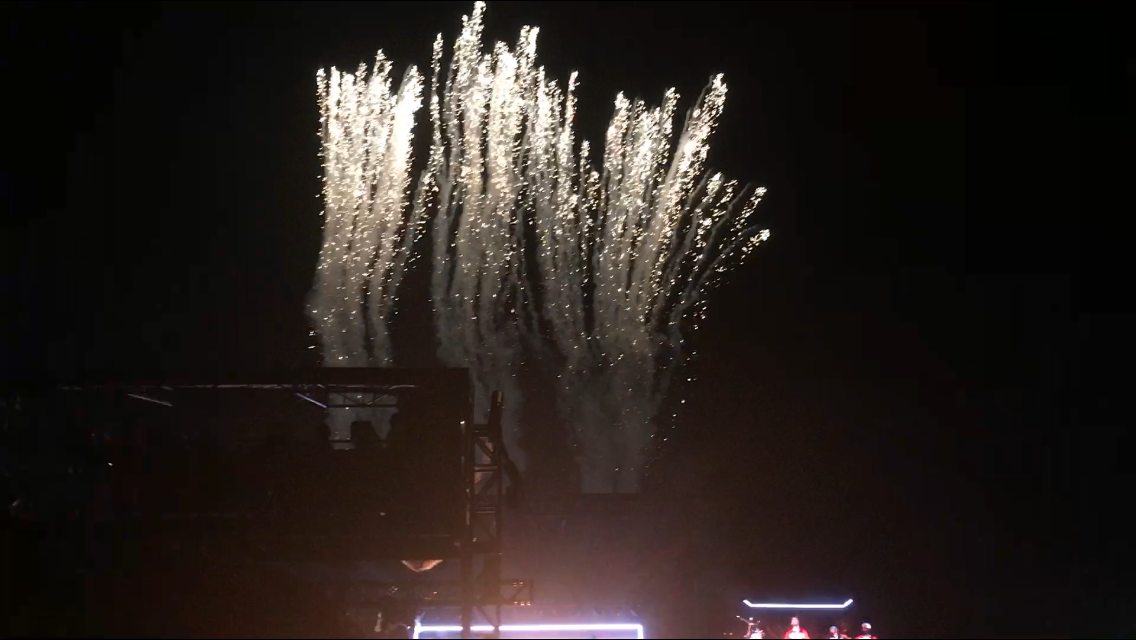 Fireworks+shoot+up+in+the+middle+of+the+performance+while+Bruno+Mars+continues+to+sing+and+dance.