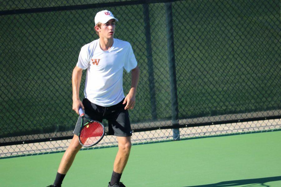 Daniel Antov '21 participates in a doubles match.