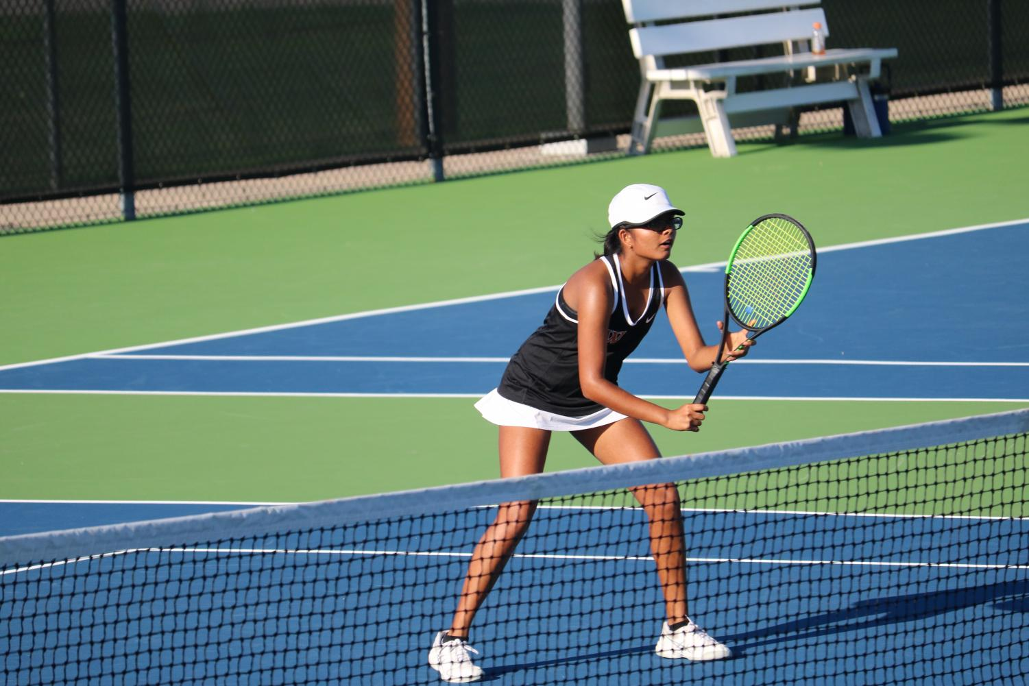 Mihika+Birmiwal+%2720+gets+into+position+before+her+doubles+match+starts.