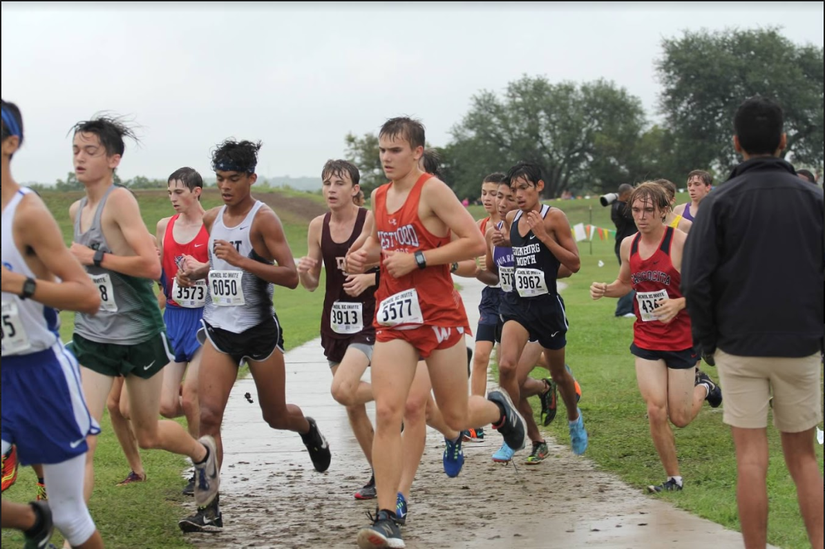 While+running+through+the+rain%2C+Zach+Shrull+%2719+focuses+on+the+race+ahead.%0APhoto+Courtesy+of+Hector+Lomeli