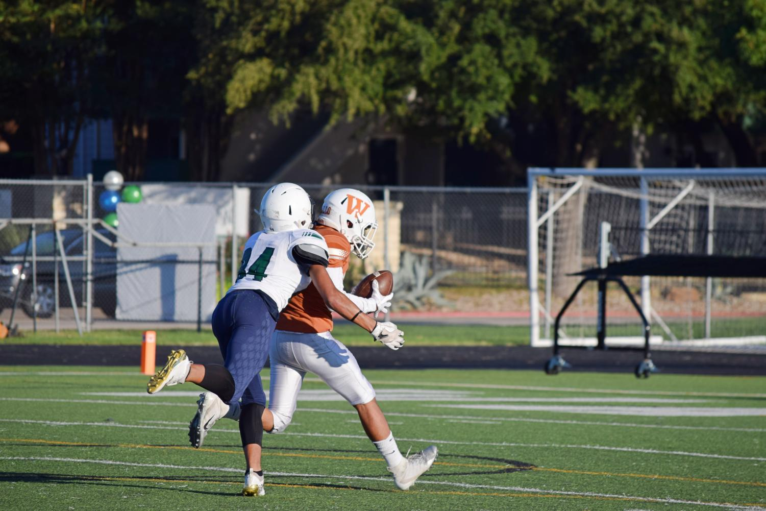 A+McNeil+receiver+runs+after+Cesar+Badillo+%2721+as+he+tries+to+sprint+to+the+end+zone.