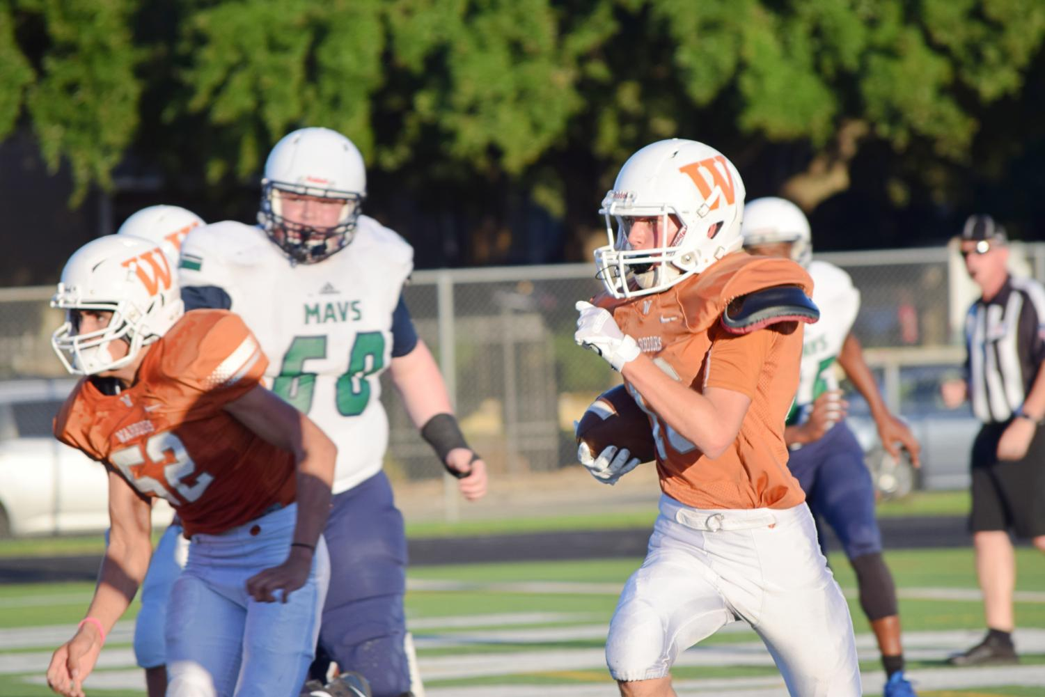 Eric+Uffelman+%2721+runs+with+ball+looking+for+an+opening+in+the+McNeil+defense.