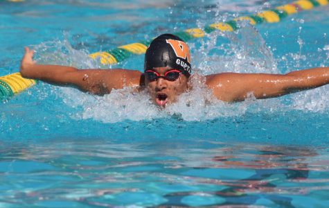 Somil Gupta '19 takes a breath during the 100-meter butterfly.