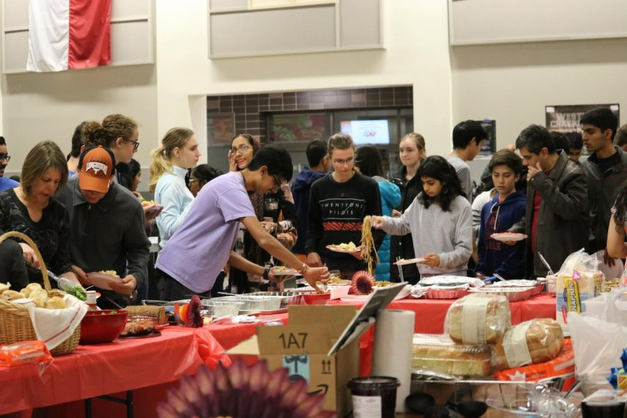 Attendees eagerly serve themselves after the talent showcase.