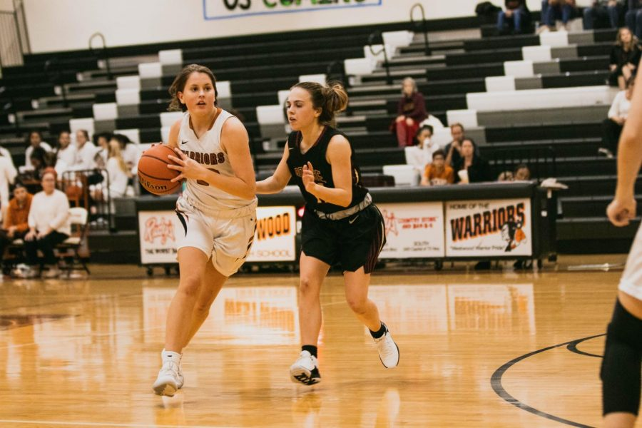 Peyton Halley '21 dribbles the ball across the court.