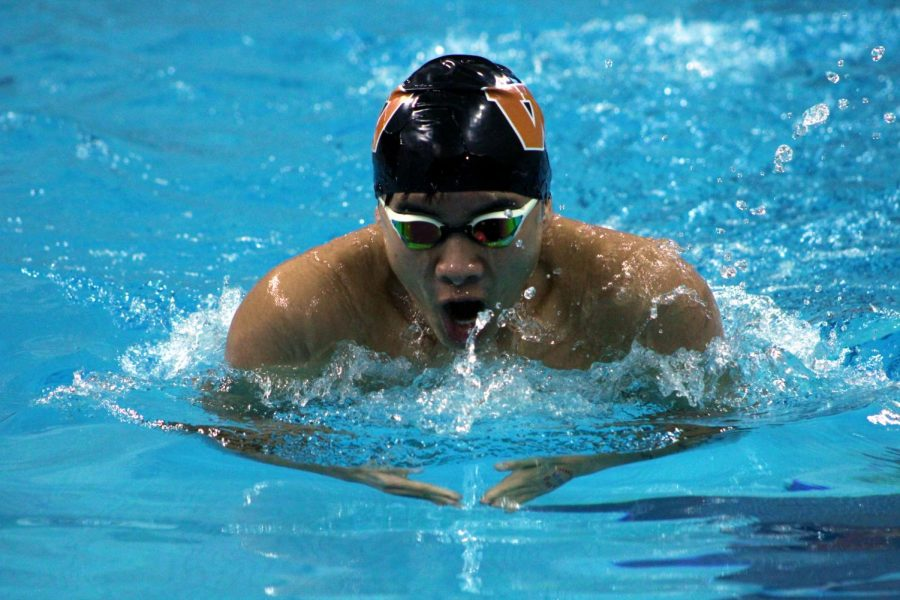 Austin Nguyen '22 breaststrokes in an event.