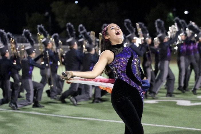 Sophia+Davis+%2720+smiles+at+the+crowd+while+performing+in+the+color+guard+routine.