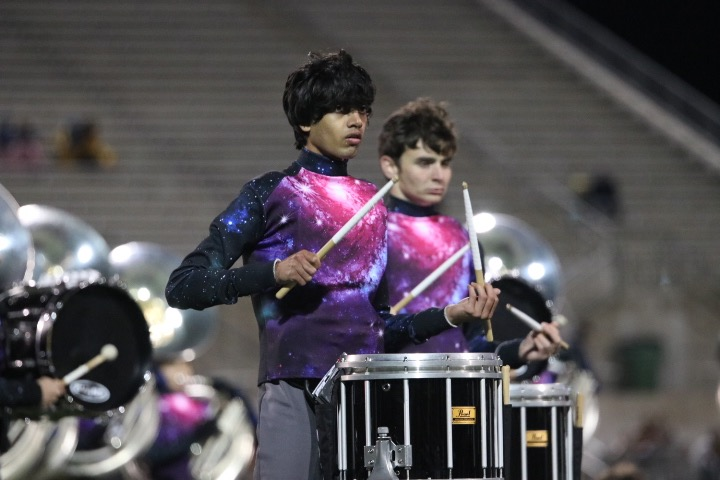 During+the+band%27s+halftime+performance%2C+Chinmaya+Andukuri+%2719+plays+the+drums.