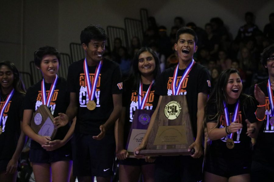 Tennis team members get excited about their state win.