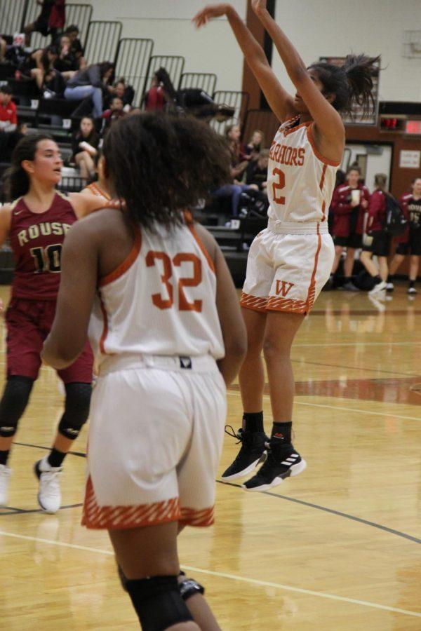 Anisha Chintala 21 shoots the ball and scores.