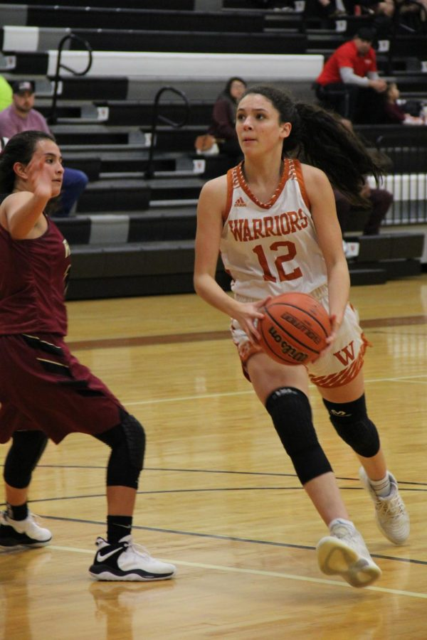 Desi Davalos 22 runs the ball up the court in an attempt to score.