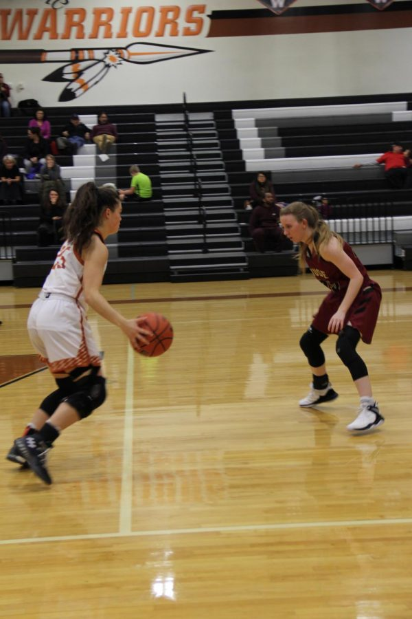 Danielle Davalos 19 runs the ball up the court and attempts to dodge an opposing player.