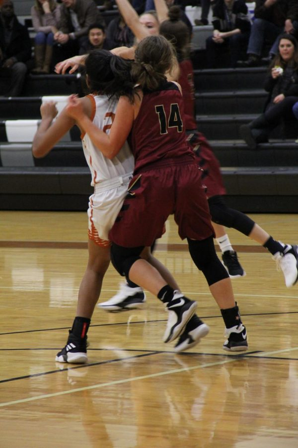 Anisha Chintala 21 plays defense on an opposing team player.