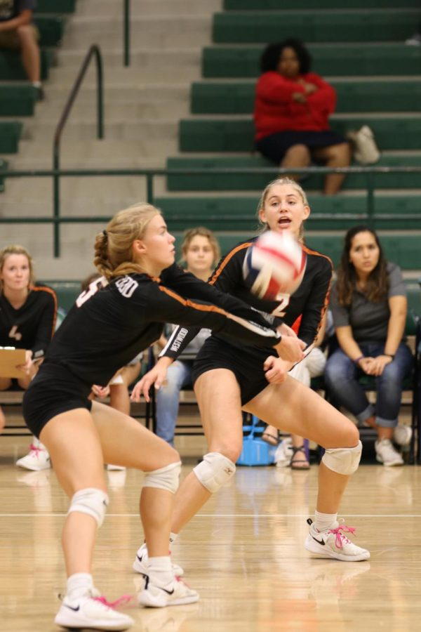 After receiving a serve, Jenny Todd '19 bumps the ball to the Warriors' setter.