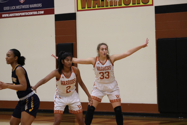 Sophomores+Ginna+Grant+and+Anisha+Chintala+play+defense.
