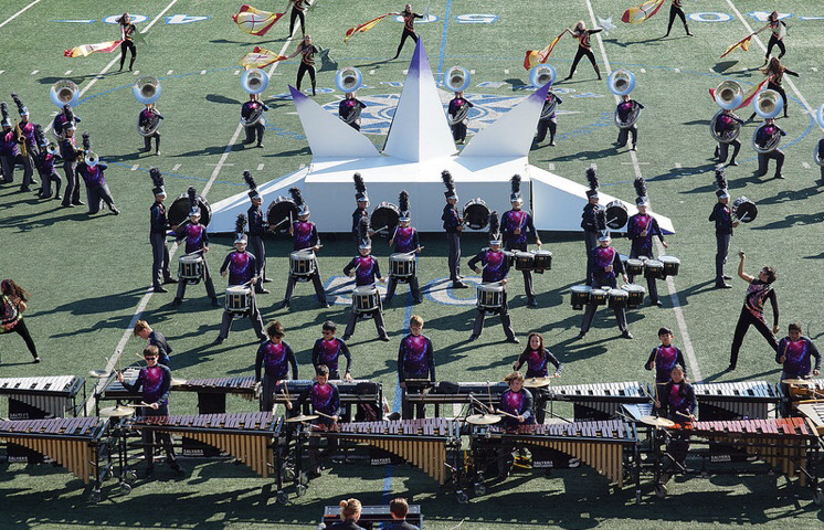 The+drumline+performs+in+front+of+the+prop.