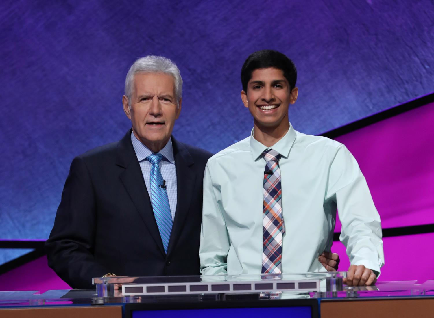 Anish Maddipoti '20 poses alongside host Alex Trebek for a photo. Photo courtesy of Jeopardy!.