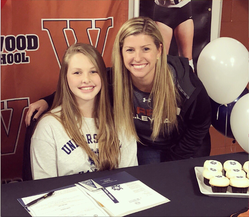 Ingrid+Stading+%2719+smiles+with+Coach+Tara+Nelson+after+signing+to+the+University+of+Dallas.+Photo+Courtesy+of+%40WarriorVball+on+Twitter