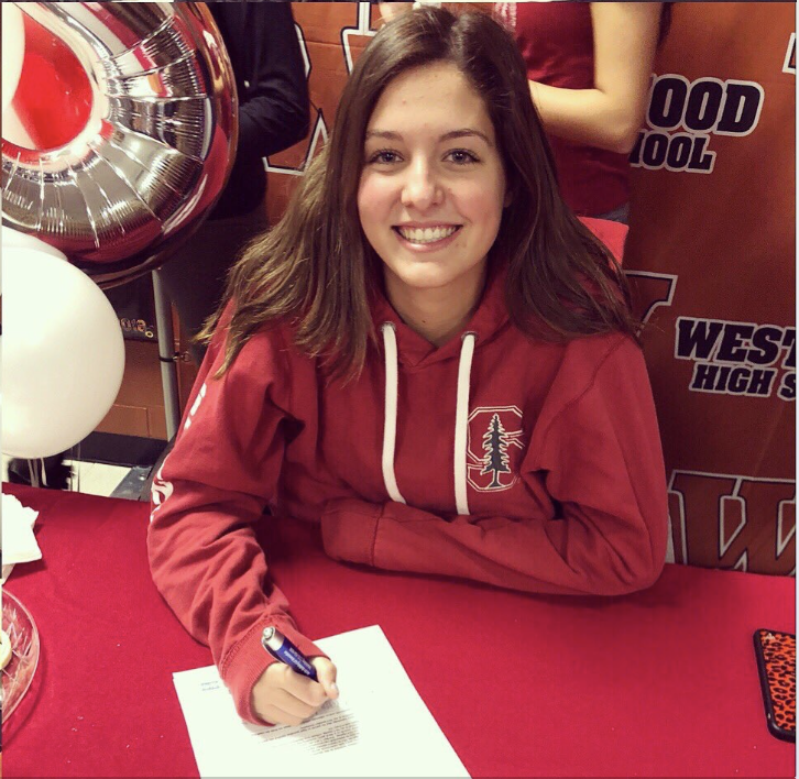 Maddi+Kriz+%2719+signs+her+NLI+to+commit+to+Stanford+University.+Photo+Courtesy+of+%40WarriorVBall+on+Twitter