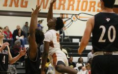Varsity Boys' Basketball Falls In Intense District Clash vs. McNeil 48-37