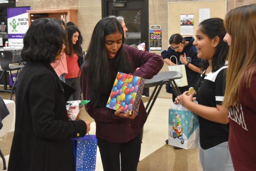 Ambassadors exchange Secret Santa gifts with each other.