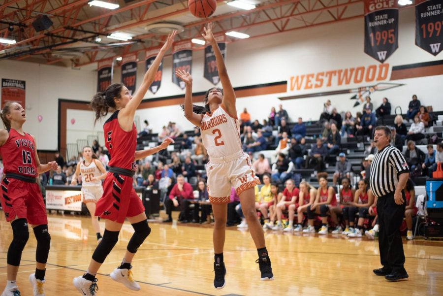 Anisha Chintiala '21 shoots the ball.