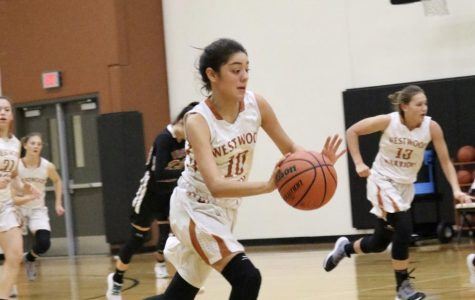 Kayla Martinez '22 dribbles the ball across the court.