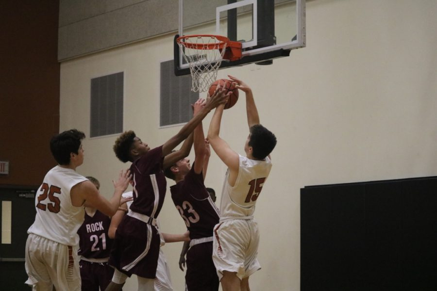 Zach Engles '22 and Carson Tuner '22 fight for a rebound.