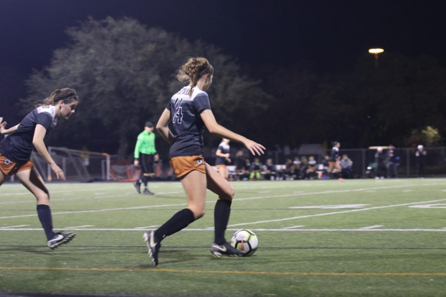 Grace Toupin '20 dribbles the ball down the field.