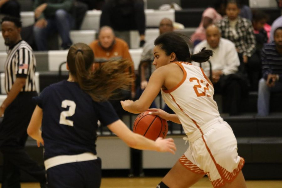 Makayla Coy '19 dribbles past an opponent in a game against Hendrickson on Jan. 16.