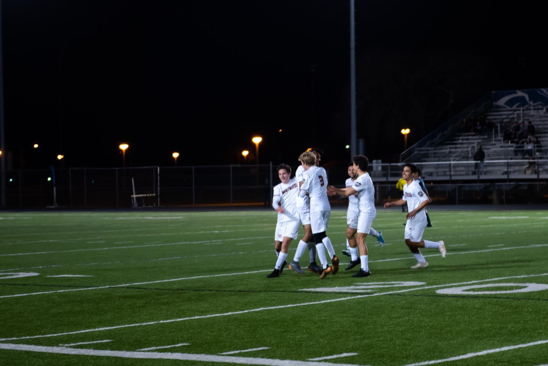 Azaan Moledina '19 celebrates with his teammates after scoring a goal.