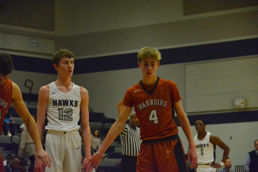 Patrick Sladek 19 high-fives a teammate after taking a free throw.