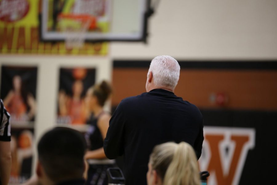 Coach Doug Davalos watches from the sidelines.