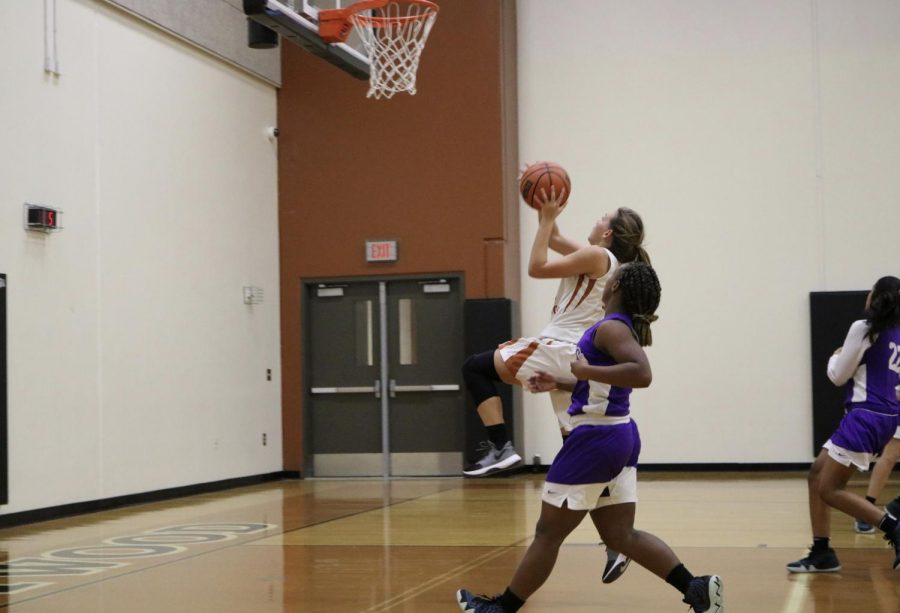 Gabbi Wallace '22 shoots a basket.