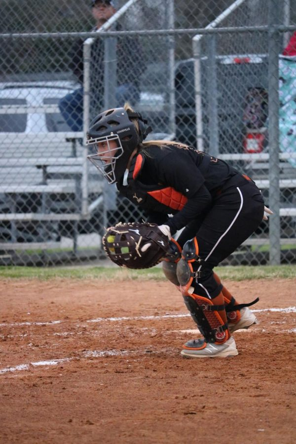 McKayla Endres 20 prepares to throw the ball back to the pitcher.