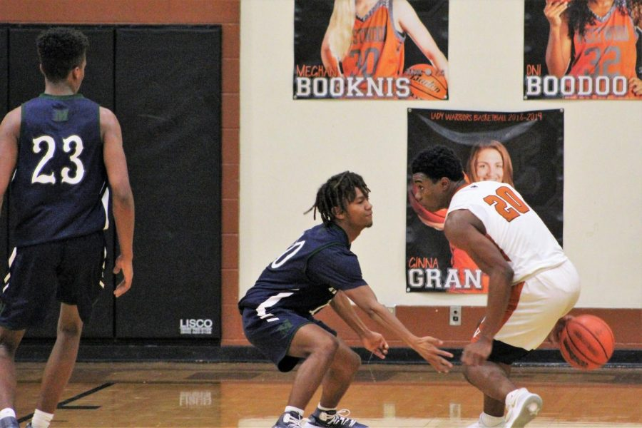 Brandon Parks 20 keeps the ball away from an opponent.