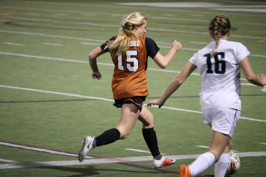 Eliza Kotick '22 chases down a McNeil player.