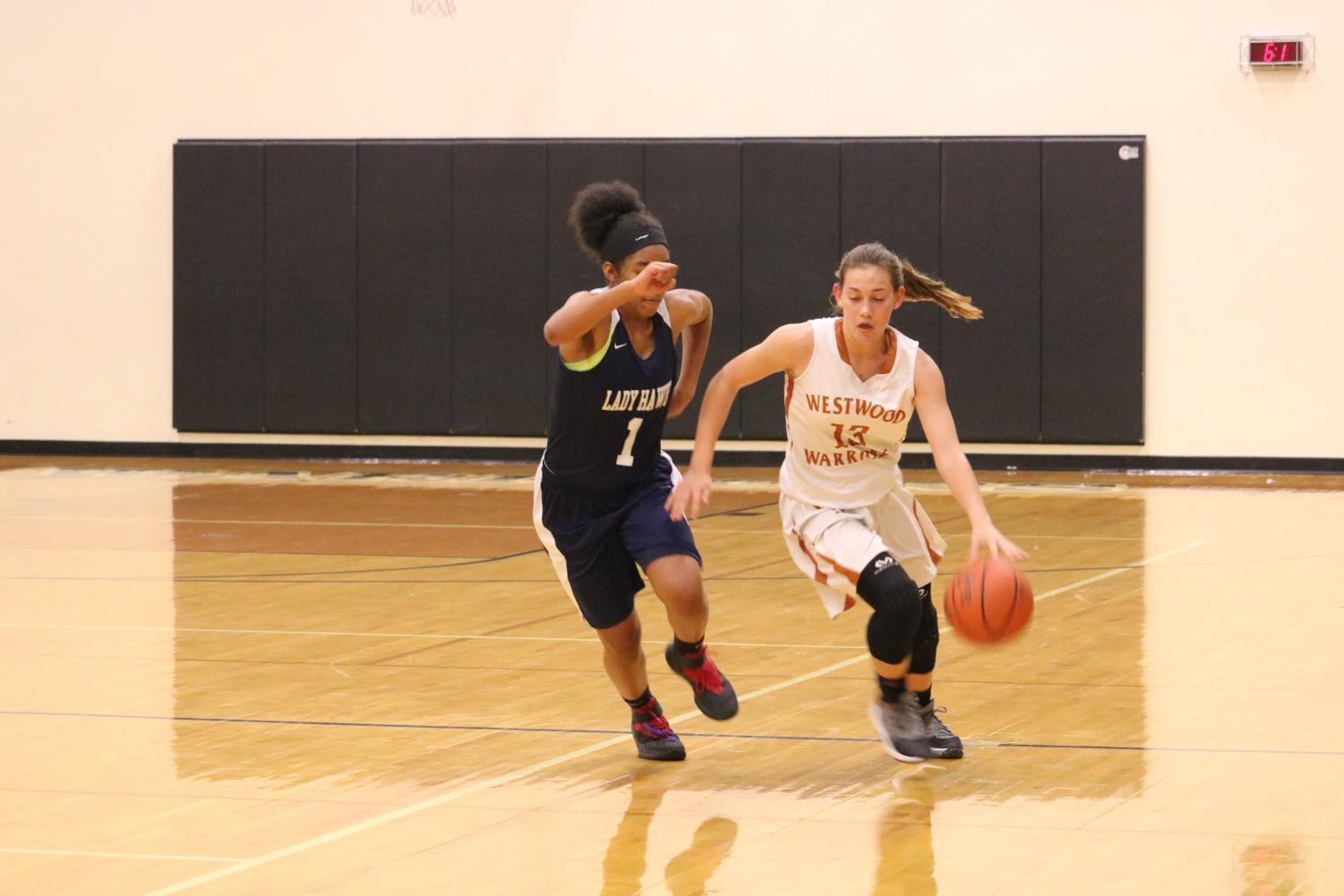 Gabbi+Wallace+%2722+defends+the+ball+from+a+Hendrickson+player.+