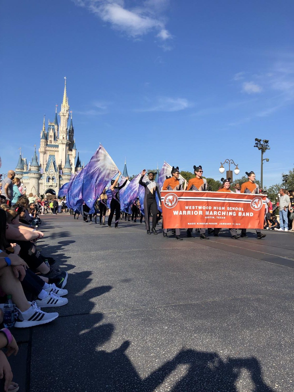 The+band+begins+the+parade+down+Disney%27s+Magic+Kingdom.