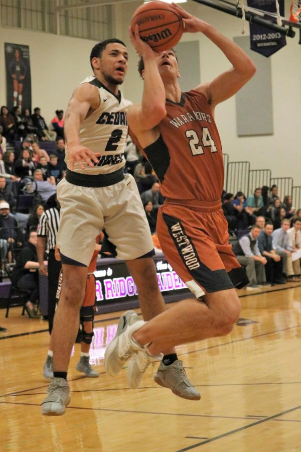 Ethan Brown 19 shoots a layup after slipping by a defender.