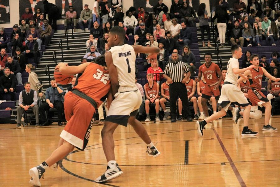 Christian Robinson 20 tries to get past a defender.