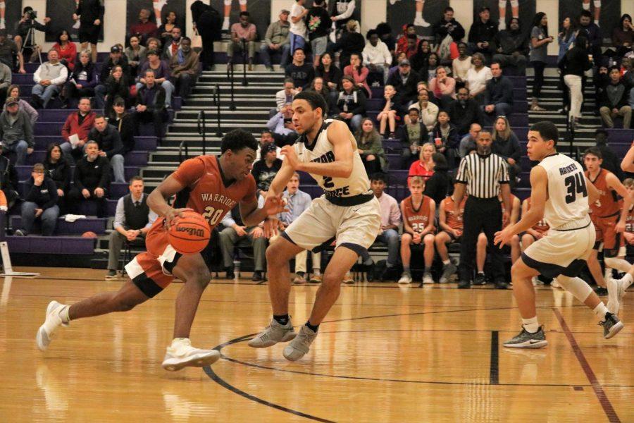 Brandon Parks 20 drives past a defender.